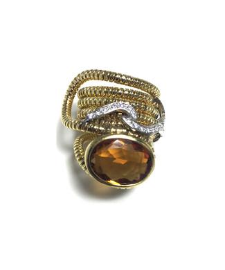 Anello mod bulgari con topazio e diamanti | Gioielleria Caruso Napoli